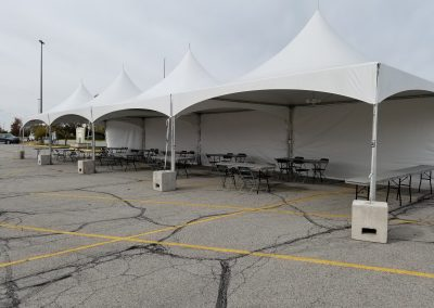 20'x80' Frame tent on blocks with solid sidewalls